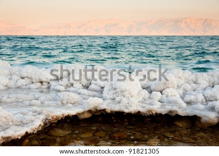 Salt-encrusted rocks along the shores of the Dead Sea at Ein Gedi, Israel. - stock photo