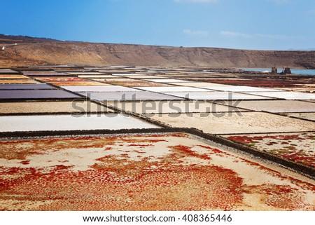 Salt extraction at Salinas de Janubio Lanzarote Canary Islands Spain - stock photo