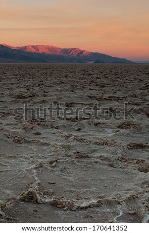 Salt flats at Badwater Basin, Death Valley National Park, California at sunset - stock photo