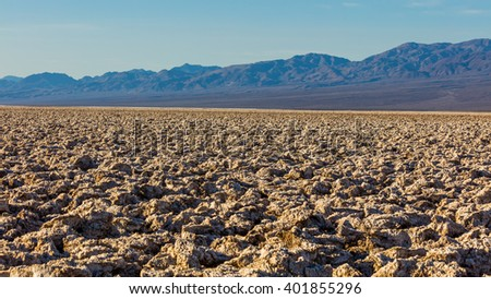 Salt has created complex structures. A rough texture from the large salt crystal formations. A large salt pan on the floor of Death Valley. Devil's Golf Course, Death Valley National Park - stock photo