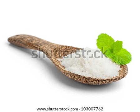 Salt in a wooden spoon - stock photo