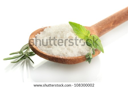 salt in spoon with fresh basil, thyme and rosemary isolated on white - stock photo
