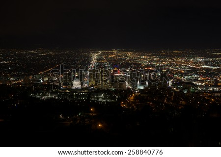 Salt Lake City at night from a nearby hill with city lights - stock photo