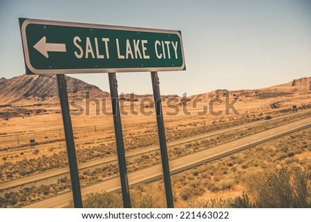 Salt Lake City Road Sign on the Interstate I-80 Somewhere near Utah and Nevada Border.  - stock photo