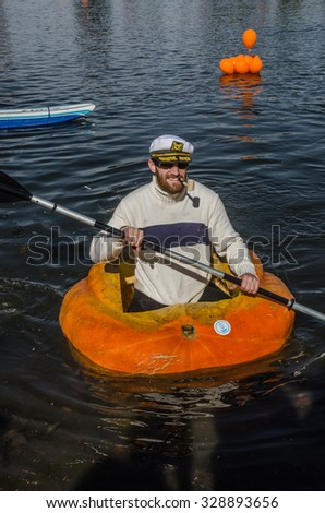 SALT LAKE CITY, UT - OCTOBER 17: Man dressed up to participate in the 5th Annual Ginormous Pumpkin Regatta 2015 at Sugarhouse Park on October 17, 2015 in Salt Lake City, Utah. - stock photo