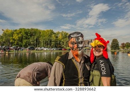 SALT LAKE CITY, UT - OCTOBER 17: People dressed up and ready to participate in the 5th Annual Ginormous Pumpkin Regatta 2015 at Sugarhouse Park on October 17, 2015 in Salt Lake City, Utah. - stock photo