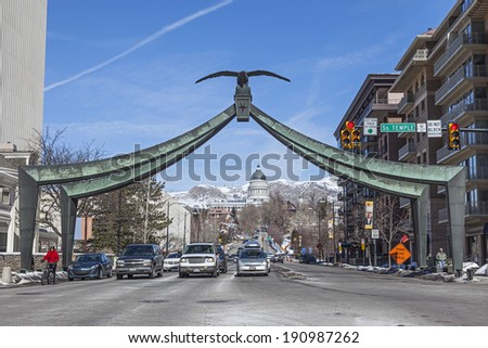 SALT LAKE CITY, UTAH - FEB. 25, 2013: The Eagle Gate with the State Capitol building in Salt Lake City, Utah. The Eagle Gate is located at Downtown Temple Street & State Street in Salt Lake City.