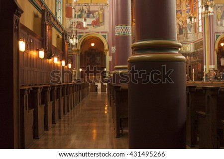 Salt Lake City, Utah, USA - 12 October 2005: Looking up the aisle or rows of wooden pews inside the Cathedral of the Madeline in Salt Lake City, UT.