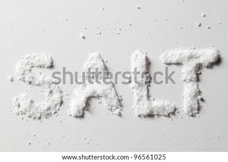 Salt on original white background with true shadows - stock photo