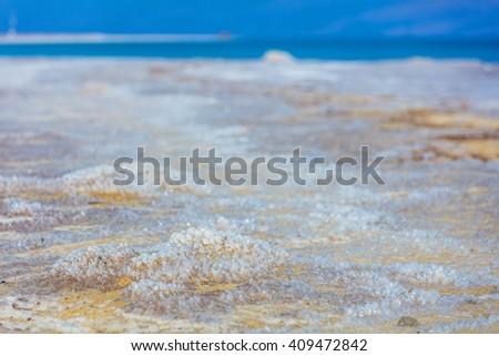 Salt on the Dead Sea coastline, Israel - stock photo