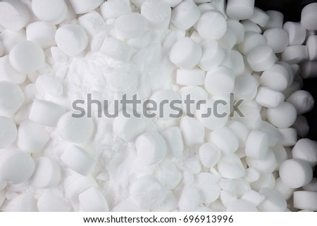 Salt pellets for environment friendly cleaning dishes. Used in dishwasher and water softener.
