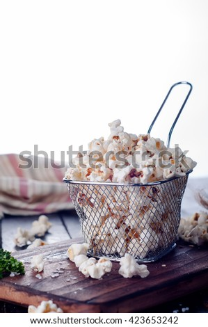 Salt popcorn  in a basket on the wooden table