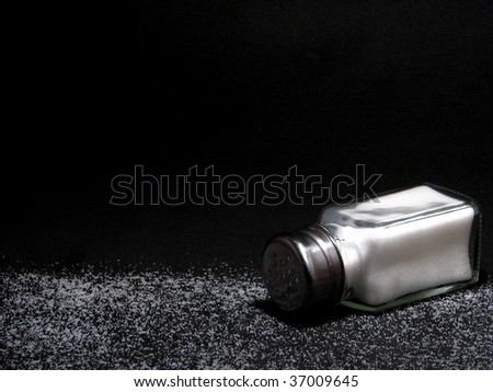 Salt Shaker on Black Background - stock photo