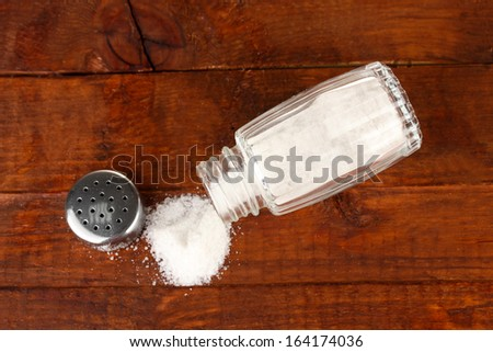Salt sprinkled on table - stock photo