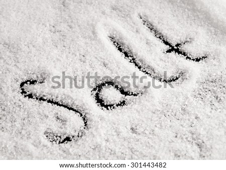 Salt surface side top view with letters - stock photo