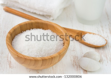 salt with spoon, towel and bottle