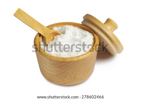 Salt with wooden spoon in bowl on white background - stock photo