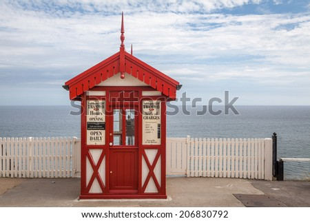 SALTBURN-BY-THE-SEA, UNITED KINGDOM - 18 JULY, 2014: Victorian style cliff tramway booth at the beach in Saltburn-by-the-Sea, UK. The Saltburn cliff is one of the oldest cliff railways in the UK - stock photo