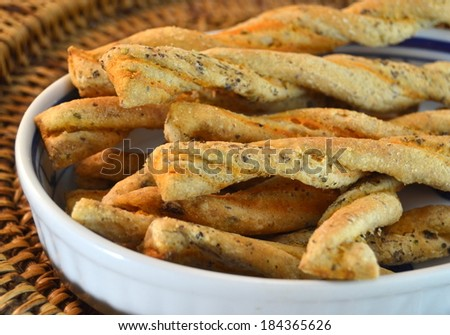 Salted bread sticks with sesame seeds for Cocktail - stock photo