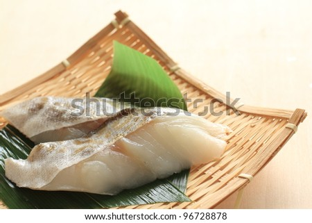 salted cod roe on bamboo basket - stock photo