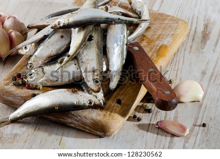 Salted fish on a wooden table