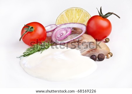 salted Herring with vegetables, spices and sauce - stock photo