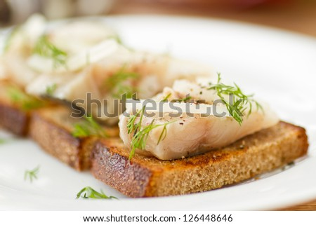 salted mackerel with grilled toast and condiments - stock photo