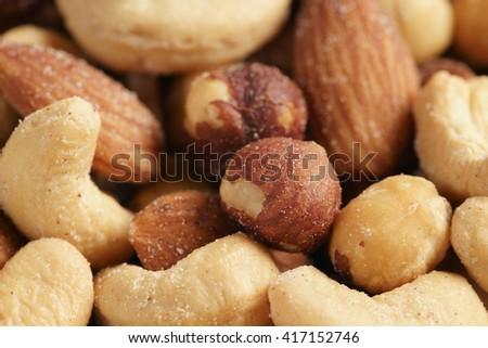 salted nut mix background, closeup shallow focus - stock photo