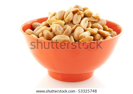 salted peanuts in orange bowls isolated over white