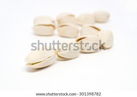 Salted pistachio nuts isolated on white background