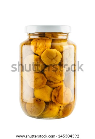 Salted plum in glass jar isolated on white background - stock photo