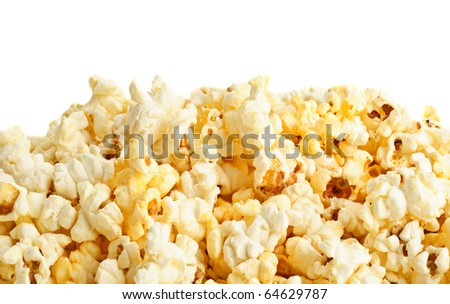 Salted popcorn grains on the white background - stock photo