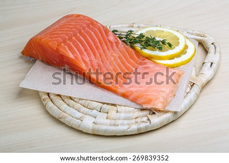 Salted Salmon on the wood background with thyme - stock photo