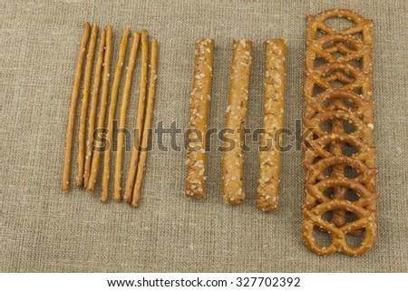 Salted sticks and pretzels. Bavarian salted pretzels. Bagel to watch sports. - stock photo