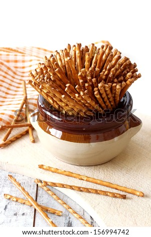 salted sticks in  cup on wooden  - stock photo