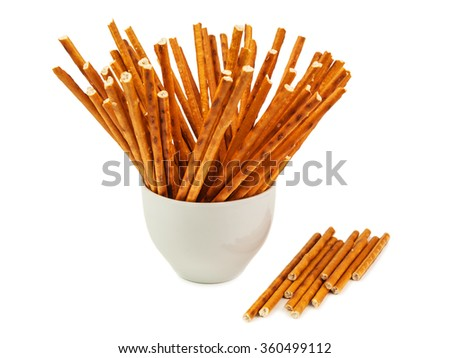 salted sticks on white background - stock photo