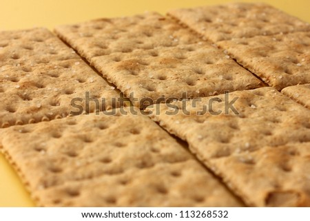 saltine wholemeal cracker biscuits tiled - stock photo