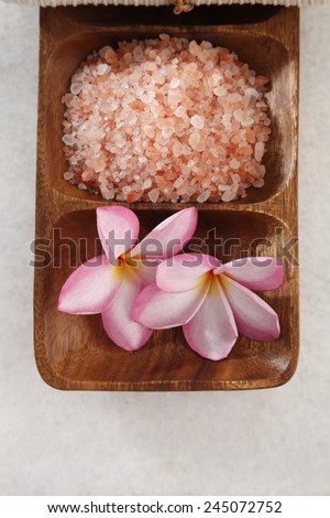 salts and frangpani flower in the wooden bowl - stock photo