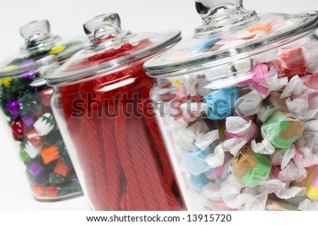 Saltwater taffy, licorice, and fruit flavored hard candy in glass containers