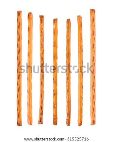 salty cracker pretzel sticks isolated on white background - stock photo