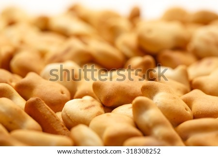 Salty crackers in shape of fish as background