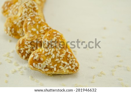 Salty heart shaped sesame crackers - stock photo