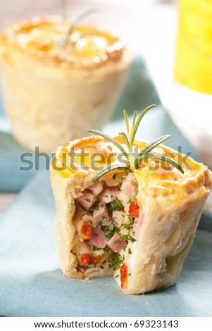 Salty muffin with ham - stock photo