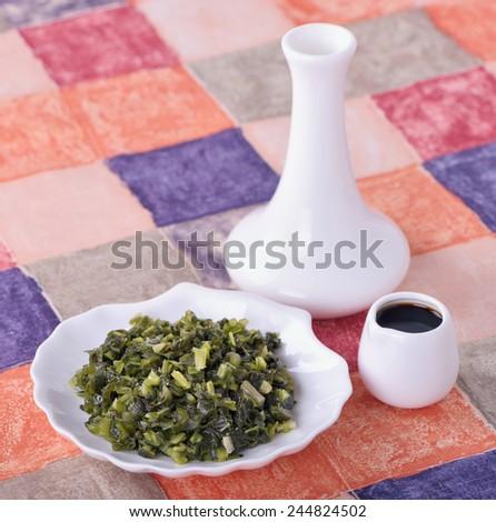 Salty pickled ramsons ( Allium ursinum) - spicy tasty appetizer - stock photo