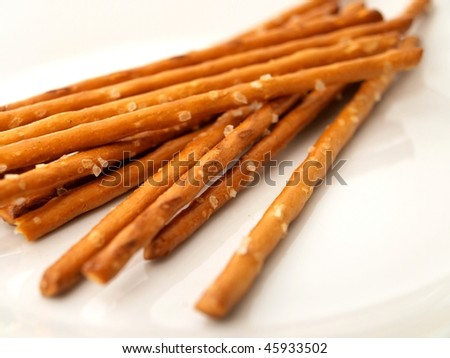 Salty sticks on a white background - stock photo