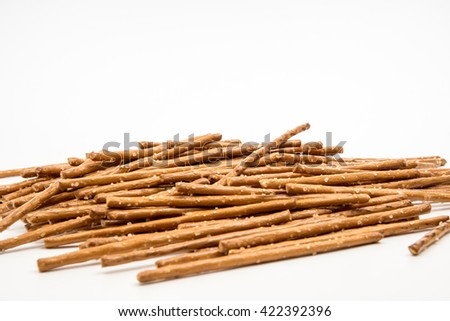 salty sticks with white background - stock photo