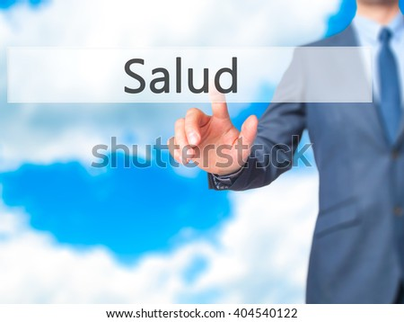 Salud - Businessman hand pressing button on touch screen interface. Business, technology, internet concept. Stock Photo