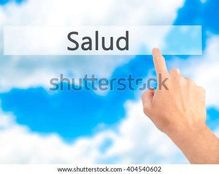 Salud - Hand pressing a button on blurred background concept . Business, technology, internet concept. Stock Photo