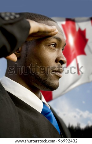 Saluting the Canadian flag - stock photo