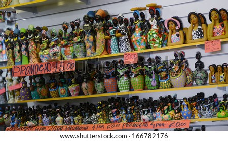 SALVADOR, BAHIA, BRAZIL:09 DEC 2013:Traditional goods are displayed inside the Mercado Modelo , a traditional place for tourism and trade on 09th Decenber 2013,in Brazil. - stock photo